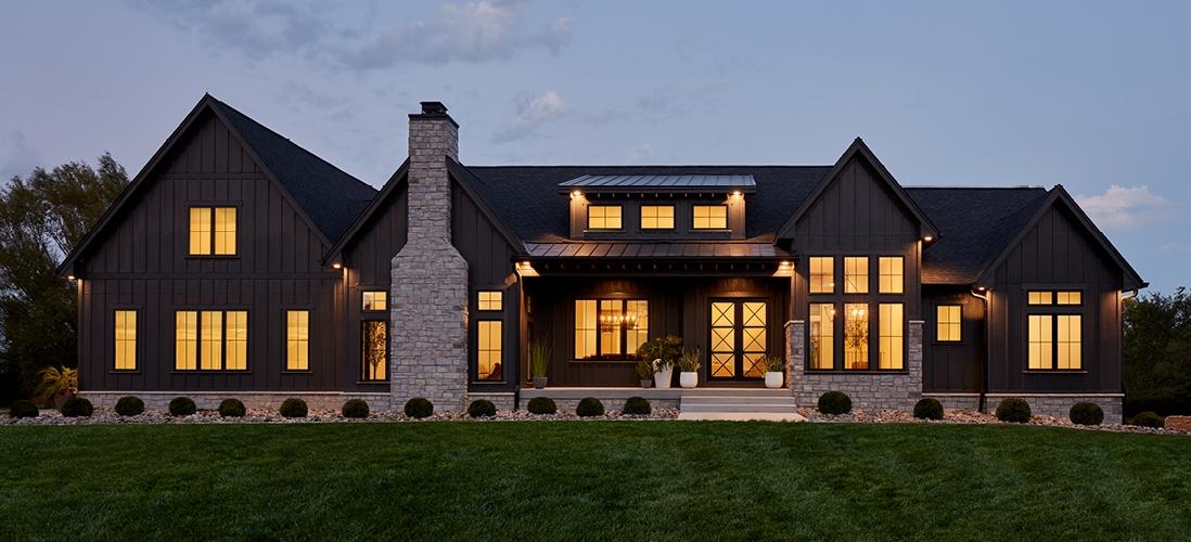 exterior home in the evening with pella fiberglass windows