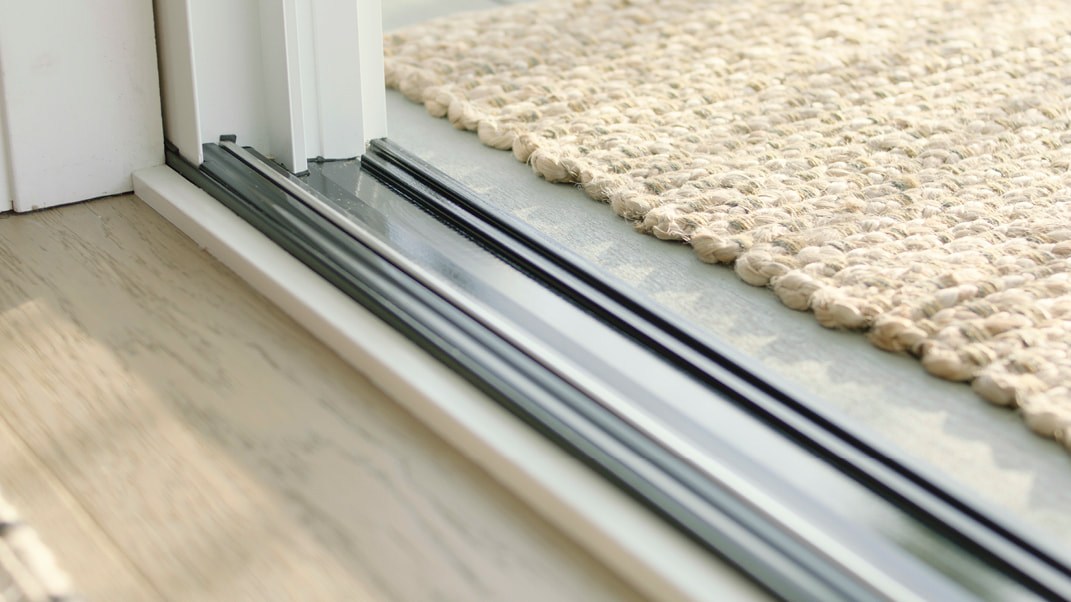 the threshold of an impervia door with a low sill