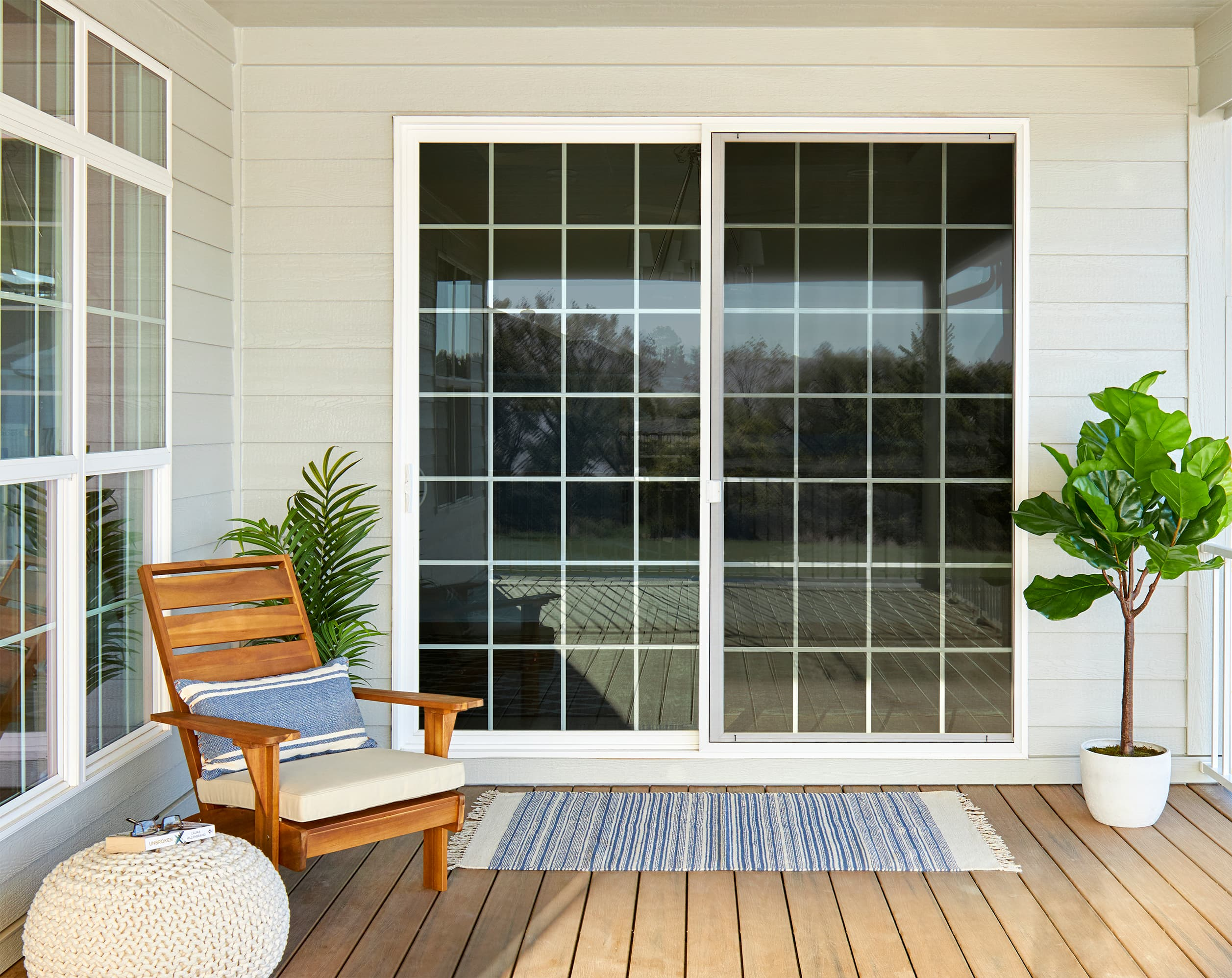 White sliding glass patio doors with traditional grille pattern on contemporary patio.