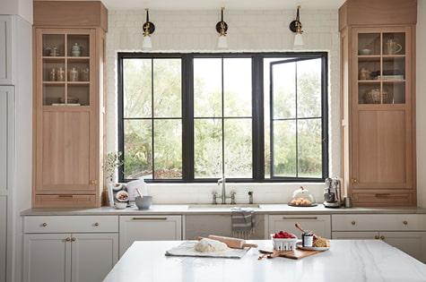 three black impervia fiberglass casement windows
