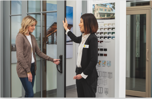 two women looking at a product inside a pella experience center
