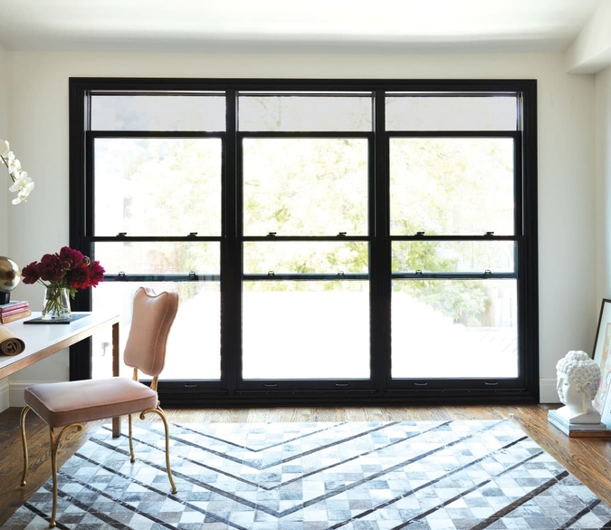 three large double-hung windows from floor to ceiling