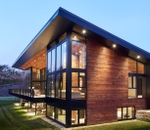 fixed frame windows form a corner unit on a reserve contemporary home