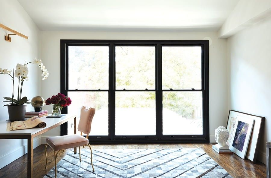 Three double hung windows beside each other in a home office space