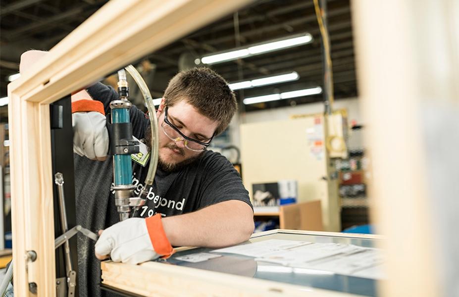 pella employee working on a pella window