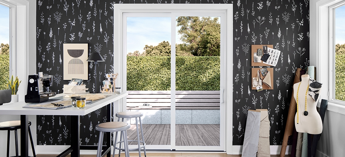 black wallpapered sewing room