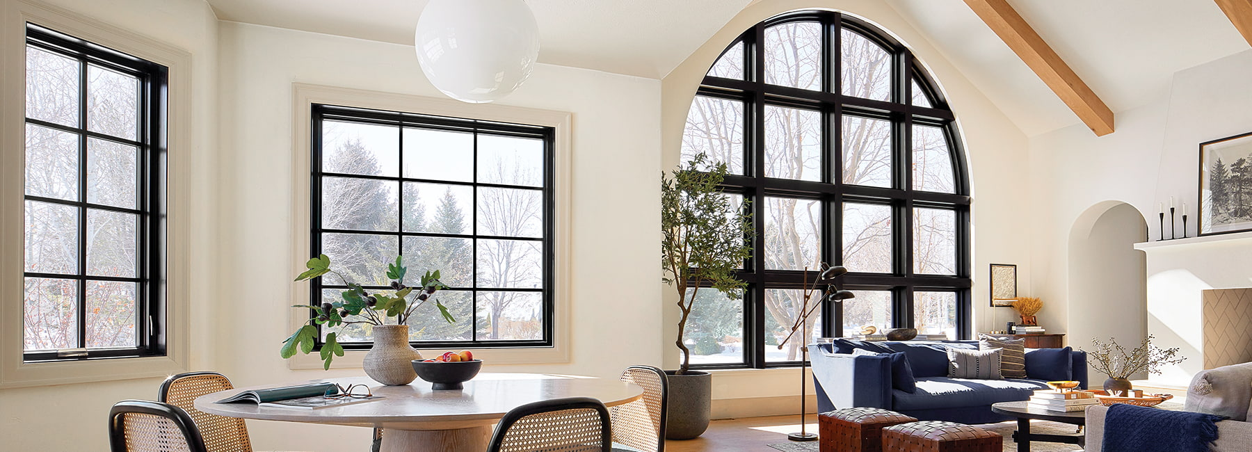 modern curved black custom window with grilles in living room