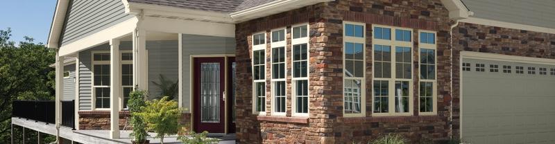 exterior shot of brick home with vinyl windows