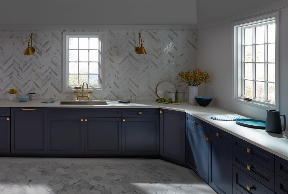 White kitchen casement windows with traditional grille pattern paired with navy cabinets