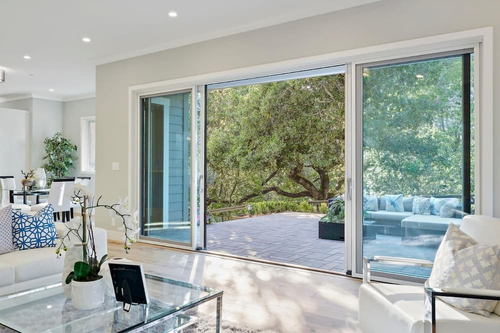 French sliding patio doors open to connect living room to outdoors