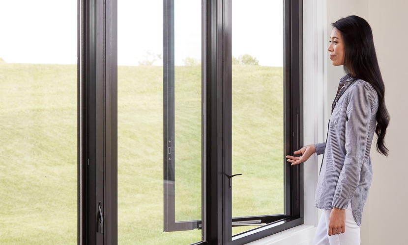 woman with white blouse using the easy slide operator on a casement window
