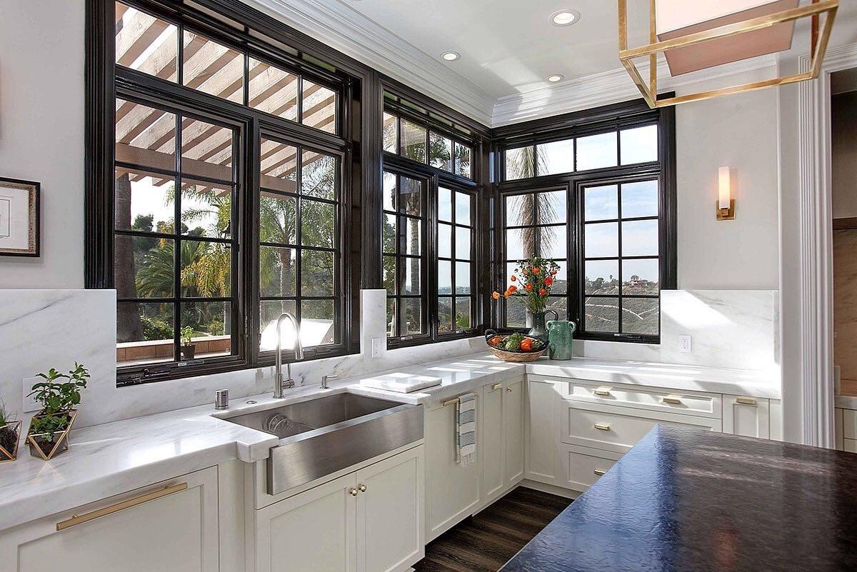 Black windows with black trim in white kitchen