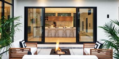 exterior shot of expansive sliding patio door with black trim