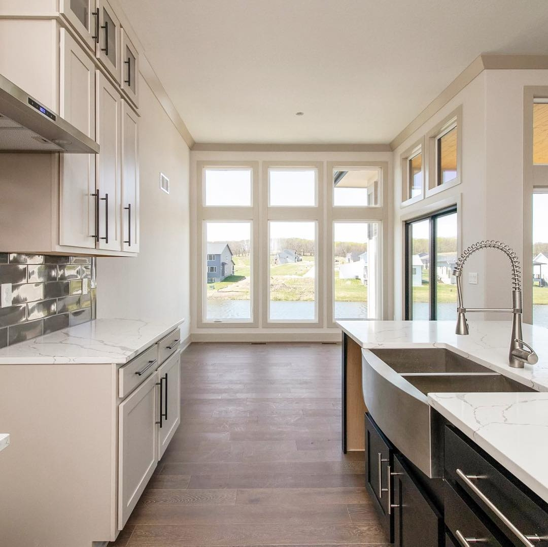 Narrow kitchen looks bigger with floor-to-ceiling casement windows