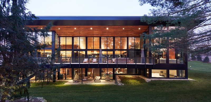 exterior of a two-story contemporary home with glass walls
