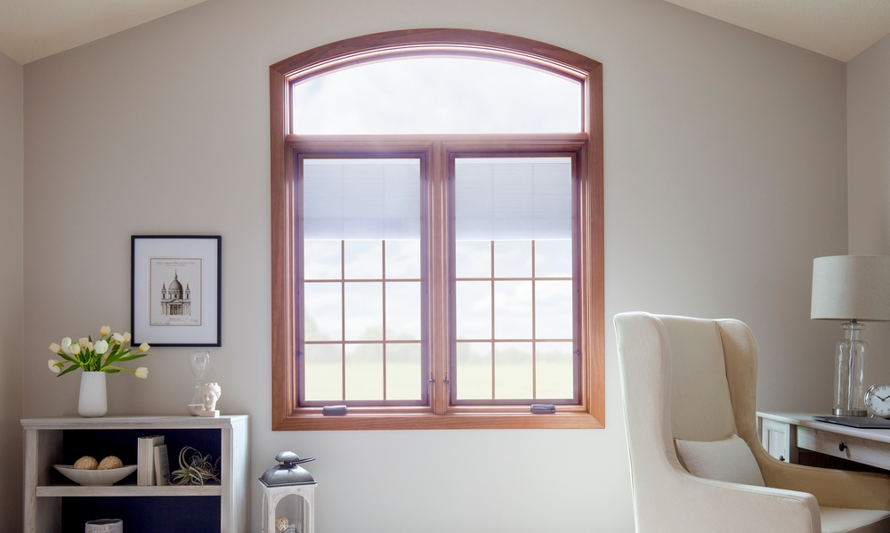 white home office with two wood casement windows with transom overhead