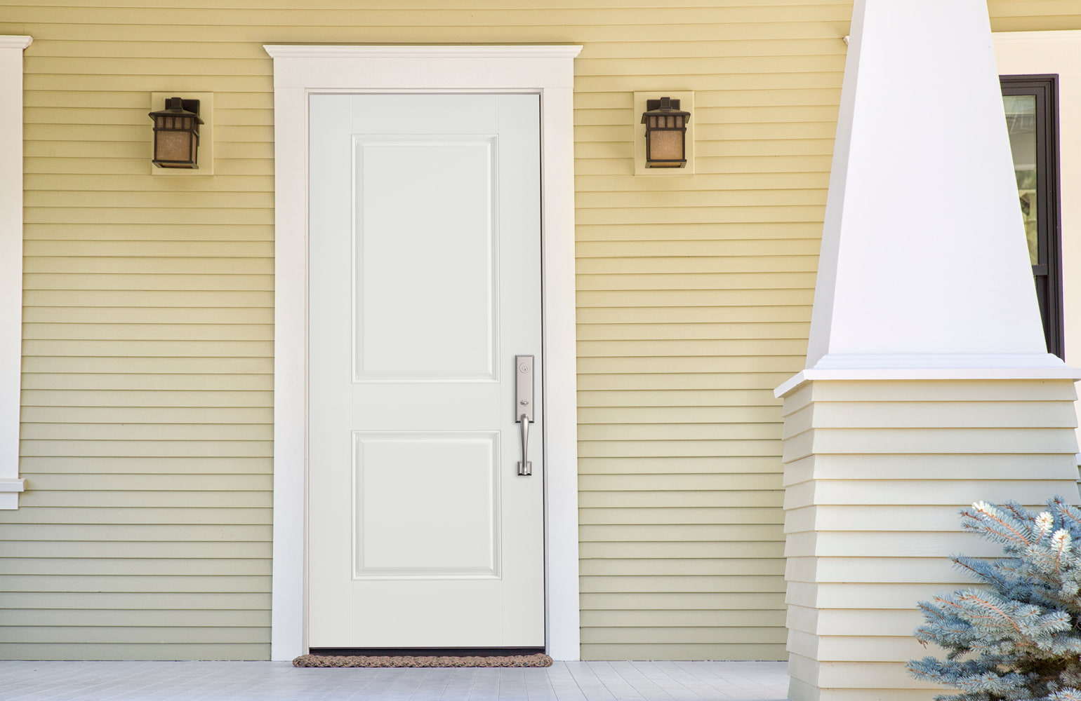 blue solid steel entry door with white trim on a light blue painted home
