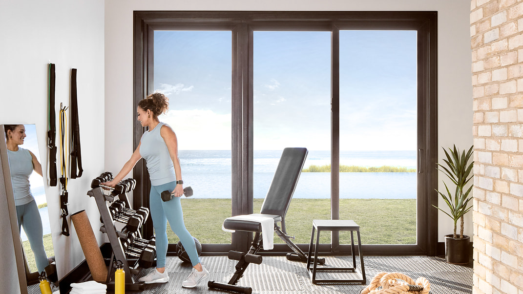 impervia sliding patio door home gym woman working out