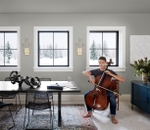 student playing the cello in front of 3 impervia awning windows