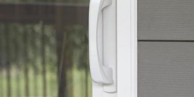 tight shot of vinyl patio door hardware handle in white
