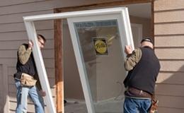two men installing a sliding patio door