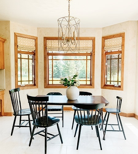 Before image of breakfast nook with wood stained windows