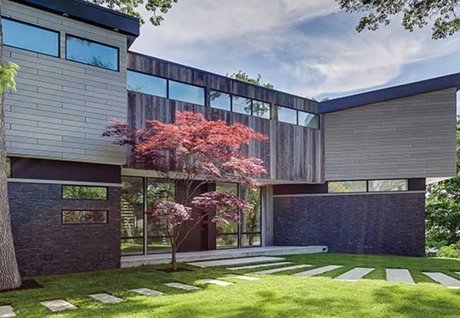 Modern home with red tree.