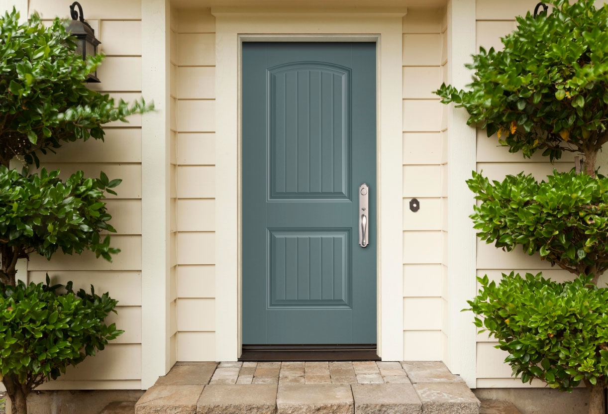 exterior view of a home with blue ash cheyenne solid fiberglass entry door