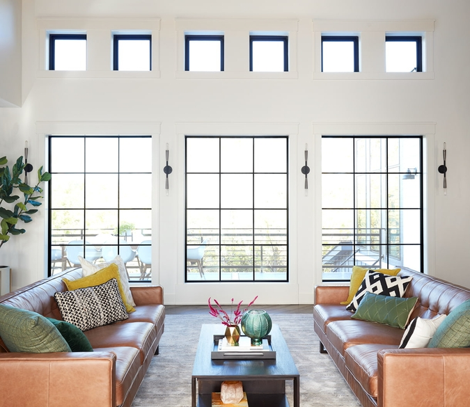 contemporary living room with 6 small picture windows and 3 large picture windows