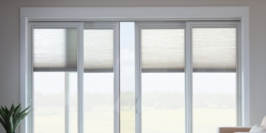 top part of a four panel sliding door with blinds between the glass