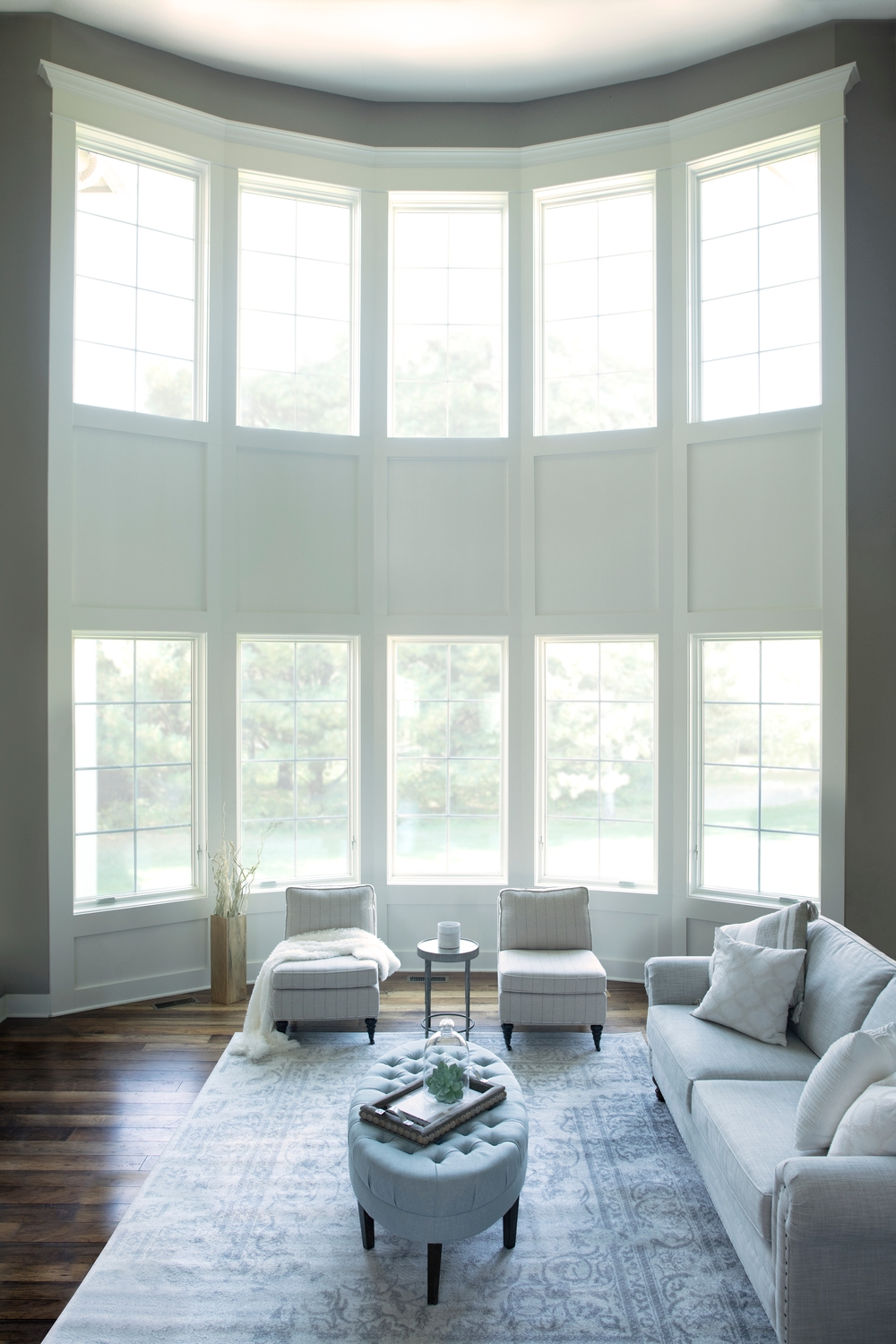Stacked casement windows create floor-to-ceiling window wall in a living room