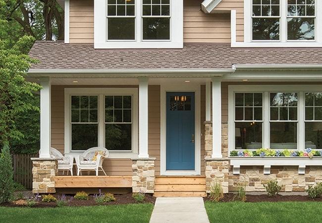Tan house with blue door.