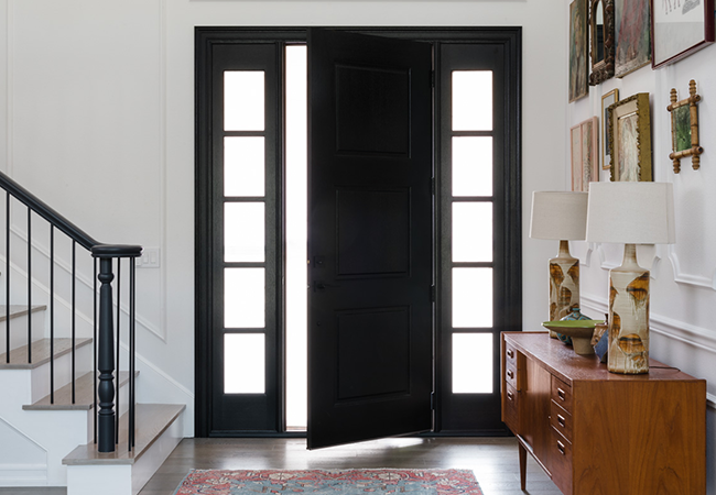 interior view of a black entry door with black trimmed sidelights on each side