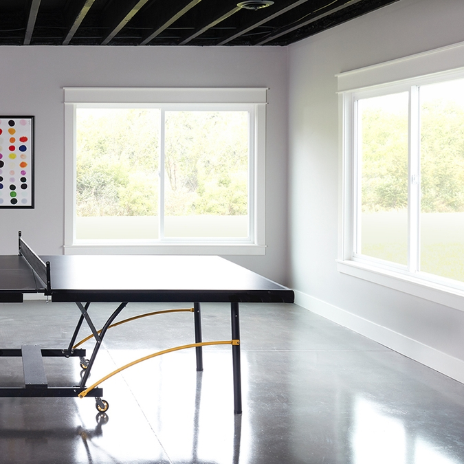 ping pong table with pella 250 series sliding windows in the corner