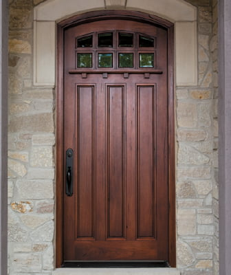 a single wood entry door installed in a brick entryway