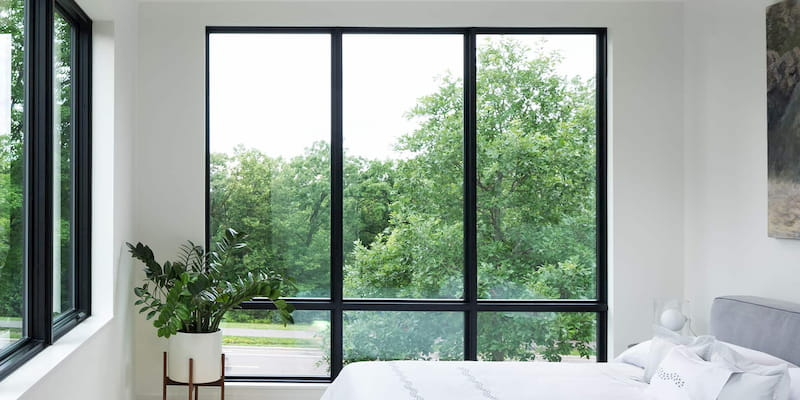 black trimmed fixed windows 3-wide