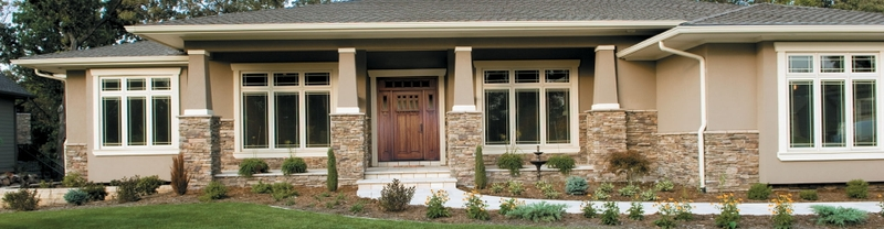 arched transom over an entry door with dual sidelights