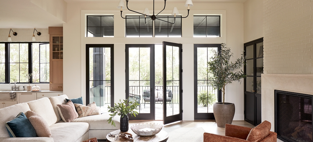 tan-colored living room with two-panel black lifestyle series french doors