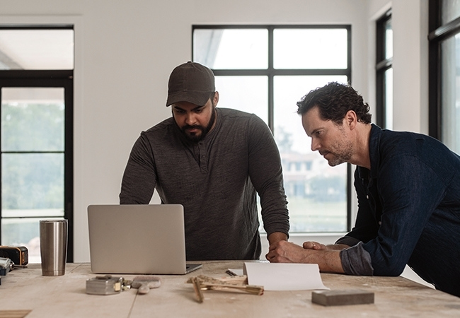 Two contractors designing a home.