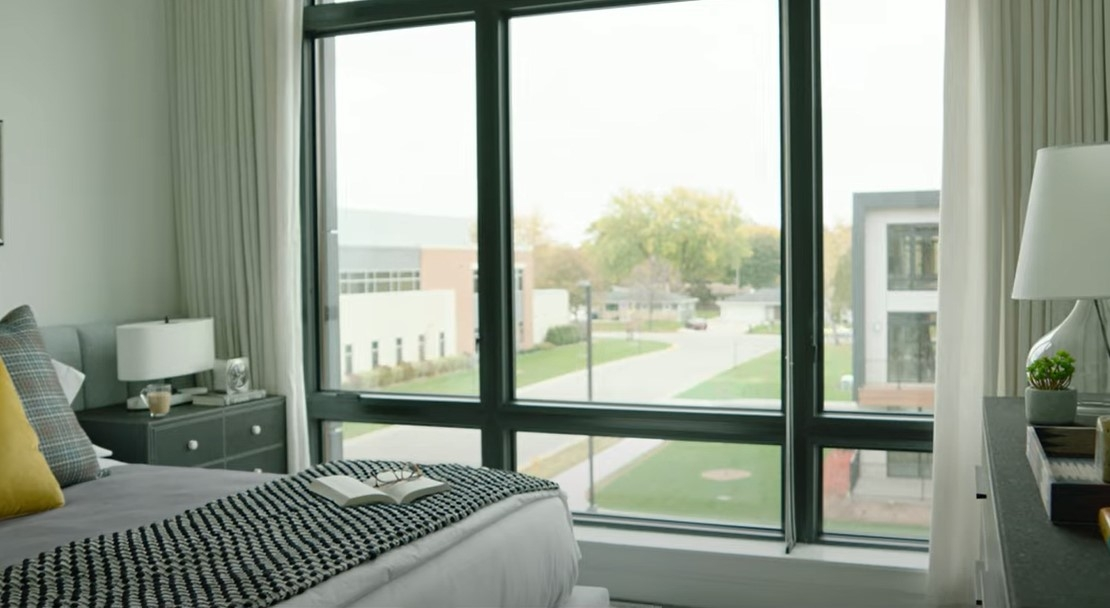 expansive pella impervia fixed windows look out over Title Town in Wisconsin