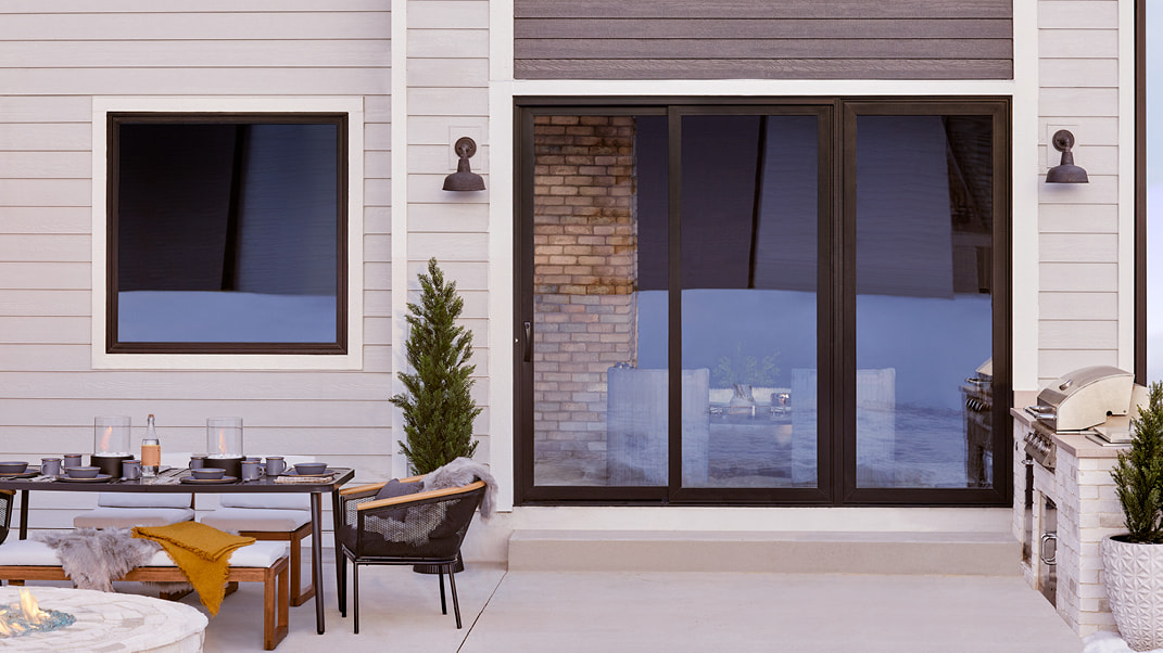 backyard of a home with an impervia sliding patio door