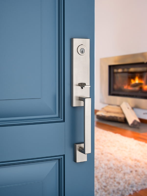 Opened blue entry door with silver handle
