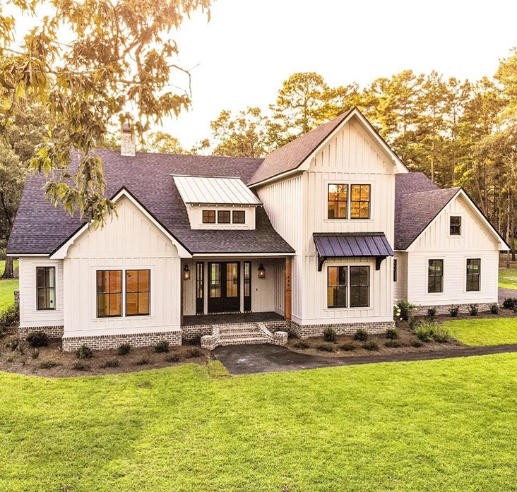 white modern farmhouse exterior with black doungle-hung windows and black front door