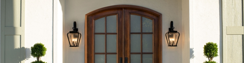 home exterior with an arched two-panel entry door