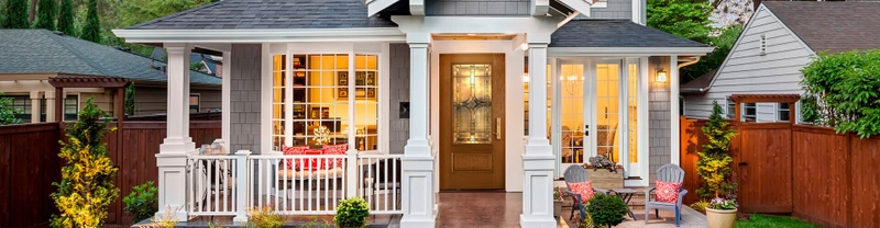 exterior home at dusk with 3/4 light entry door in provincial stain with huxley