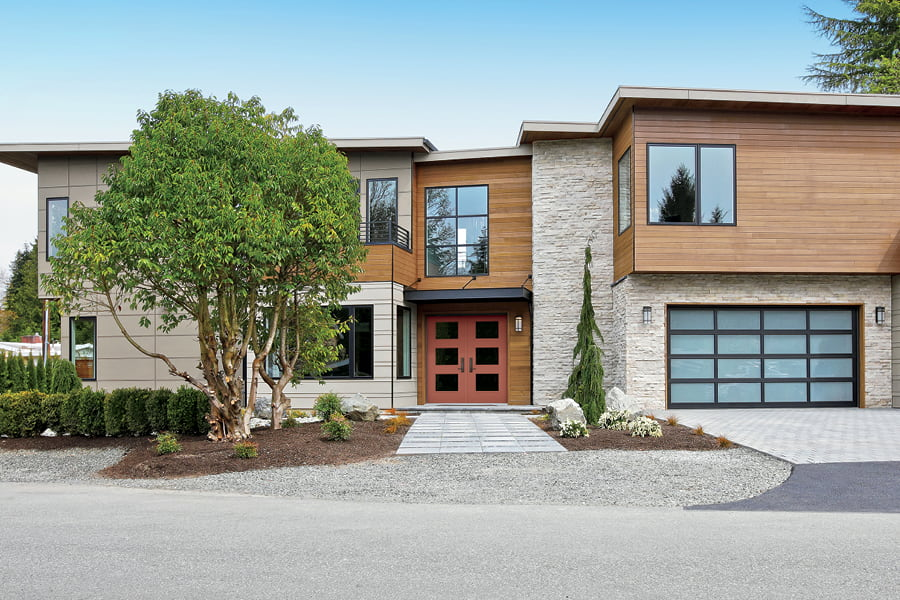 Contemporary two-story home with red double front door