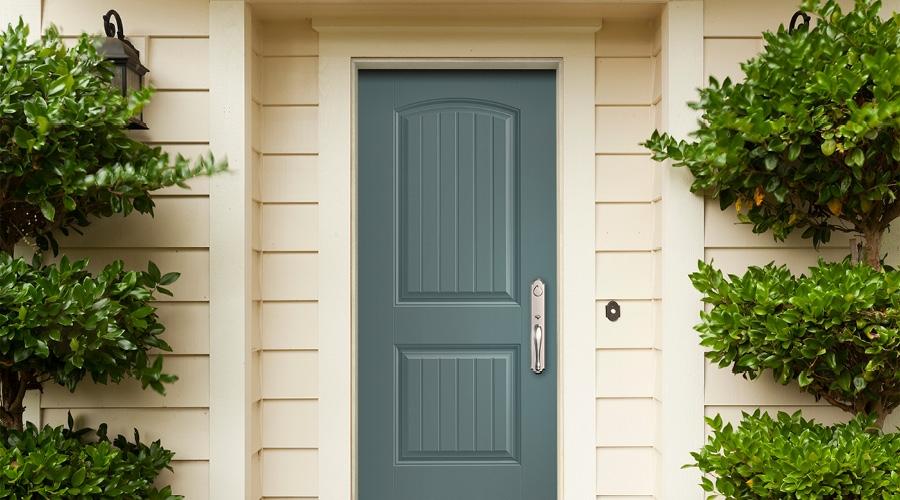 Cheyenne Blue Ash Fiberglass Entry Door of White Paneled Home