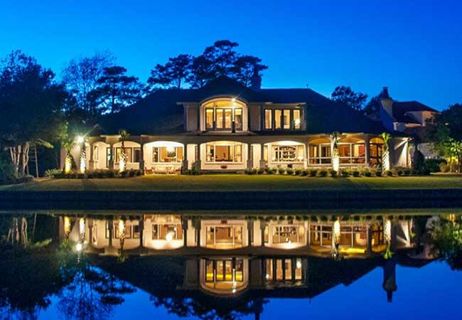 Lakeside cream-colored home.