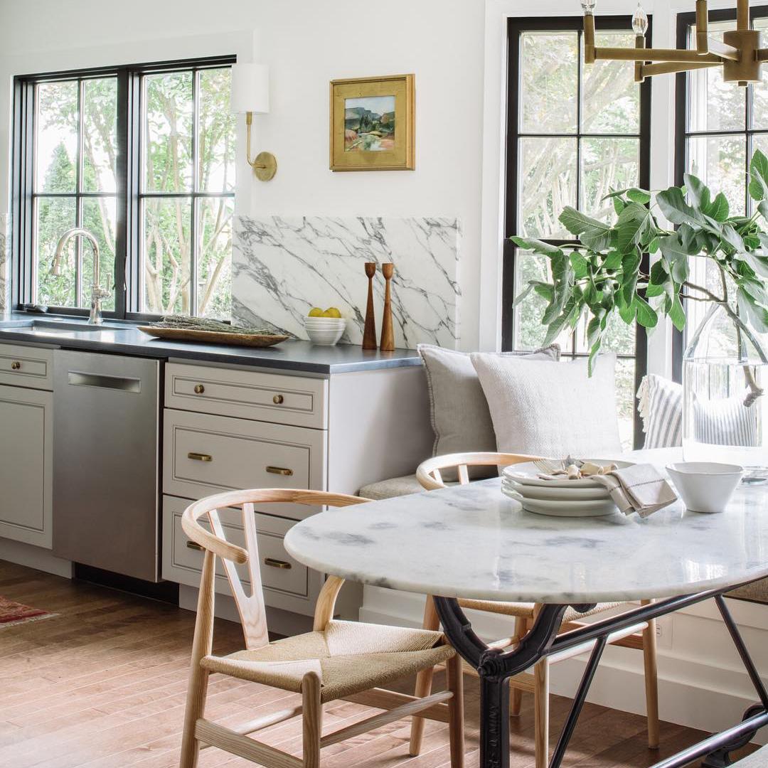 Black frame windows let light in to kitchen breakfast nook