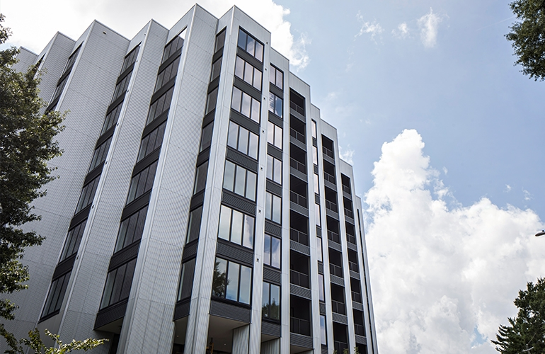 Passive House apartment building with multiple stories of Pella windows